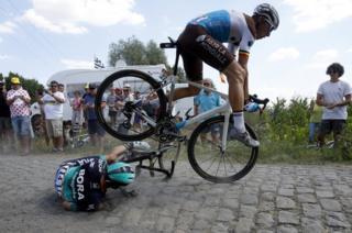 Belgian Olivier Naesen rides over Rafal Majka of Poland.