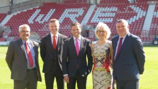 Wrexham council chief executive Ian Bancroft, Wrexham AFC director Spencer Harris, Welsh Economy Minister Ken Skates, Prof Maria Hinfelaar of Glyndwr University, and Wrexham council leader Mark Pritchard