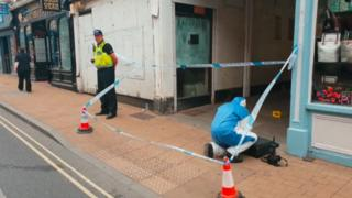 Cordoned off alleyway and police officers