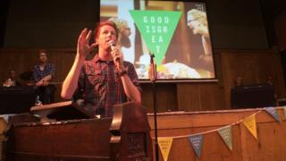 A speaker at the Sunday Assembly in London