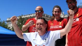 Tottenham fan and Liverpool fans