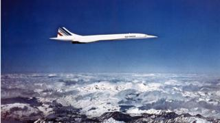 Concorde flying over some snowy mountains