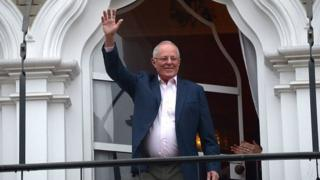 Pedro Pablo Kuczynski waves after casting his vote at a polling station in Lima on June 5, 2016.