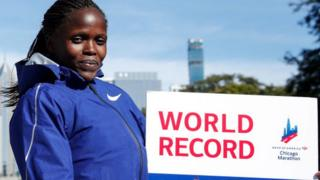 Kenya's Brigid Kosgei smiles after winning the women's 2019 Chicago Marathon - 13 October 2019