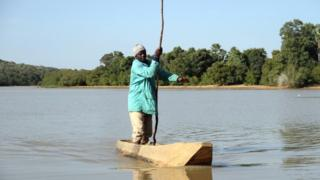 in_pictures A fisherman on a fishing boat on Lake Wegnia in Koulikoro region, Mali - Saturday 23 November 2019