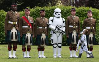Five year old Alexander Drummond from Callander inspecting soldiers from 7 SCOTS Royal Regiment of Scotland and a stormtrooper