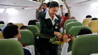 "Passengers are welcomed by cabin crew inside an Ethiopian Airlines flight who departed from the Bole International Airport in Addis Ababa, Ethiopia, to Eritrea""s capital Asmara on July 18, 2018"
