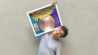 Flume - pictured with a gold disc for his record Say It, in October 2016