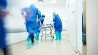 Medics in hospital corridor