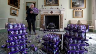 Claire Grant from the National Trust for Scotland with a pile of Easter eggs in the Drawing Room at the National Trust's Georgian House in Edinburgh