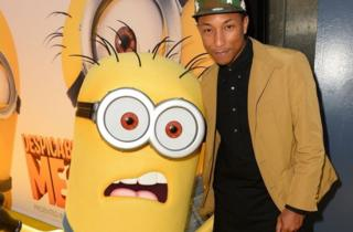 Pharrell at the Despicable Me 2 premier with a minon