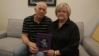 Judy and Dennis Shepard hold a photo of their son at the Denver office of the Matthew Shepard Foundation on 17 October 2018