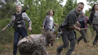 Rick Grimes kills a Zombie with an axe