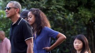Former US president Barack Obama (left) with his daughter Malia Obama (centre) visit the Borobudur Temple in Magelang, Central Java (28 June 2917)
