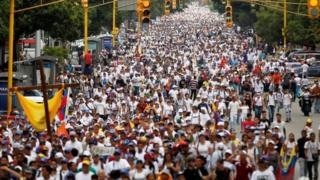 """Demonstrators during a protest against Venezuela's President Nicolas Maduro""""s government in Caracas 22 April 2017"""