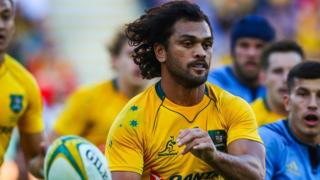 Karmichael Hunt of Australia passing the ball during international rugby match between Australia and Italy at Suncorp Stadium in Brisbane. 24 June 2017