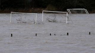 Tree debris was washed away on flooded football pitches in Tadcaster, North Yorkshire