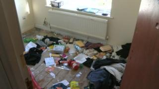 Room strewn with rubbish