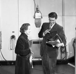 Barbara Burnham, producer, watches Robert Eddison (Lavache) rehearsing with is tabor.