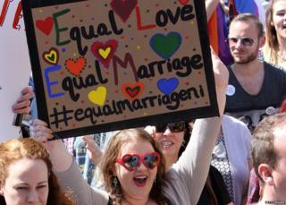 "A sign from a pro-gay marriage march in Belfast saying: ""equal love, equal marriage"""