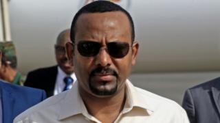 "In this file photo taken on June 07, 2019 Ethiopia""s Prime Minister Abiy Ahmed (C) arrives at Khartoum international airpor"