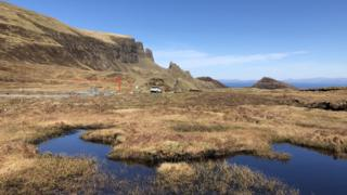 A single car parked at the Quiraing