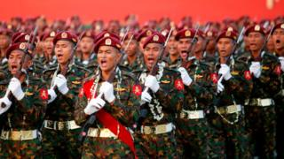 Myanmar soldiers march in formation during a military parade in Nay pyi daw on March 27, 2018