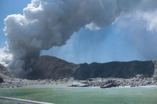 Whakaari, also known as White Island, New Zealand, spews steam and ash following an eruption on 9 December 2019