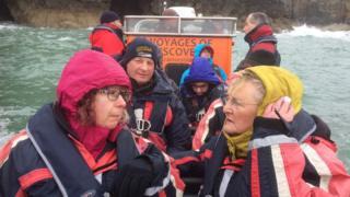Family members of Wladyslaw Kiedrzynski and Bertie Griffiths onboard a boat