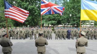 Flags held up by soldiers during opening ceremony ,6 June 2016