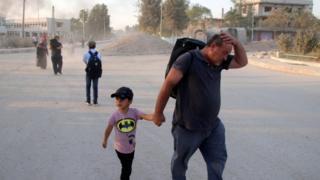 Residents flee their home town of Ras al-Ain