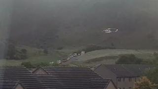 Helicopter and emergency vehicles at Arthur's Seat