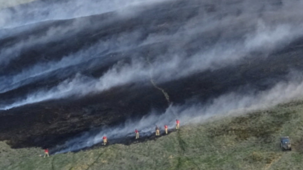 Fire crew tackles blaze smoke