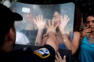 Protesters scuffle with police during a protest
