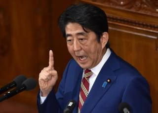 This file picture taken on 22 January 2016 shows Japanese Prime Minister Shinzo Abe delivering his policy speech at a plenary session of the House of Representatives in Tokyo