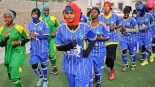Somali football players of Golden Girls Football Centre, Somalia's first female soccer club, attend their training session at Toyo stadium in Mogadishu,