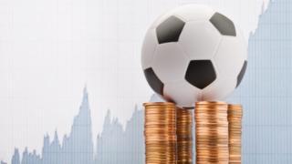 Balón sobre monedas