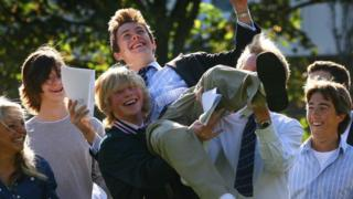 Student being held aloft getting A-level results
