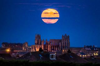 The Supermoon rises above Whitby Abbey in Yorkshire