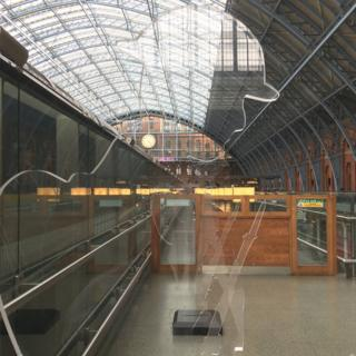 The installation of three 'There But Not There' Tommies at St Pancras Station in London