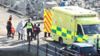 Migrants lead away in Dover