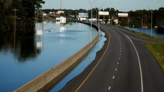 Flooded highway 95 is covered with water as a result of Hurricane Matthew in Lumberton, North Carolina, U.S. October 10, 2016