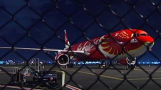 The AirAsia X plane on the tarmac at Brisbane Airport
