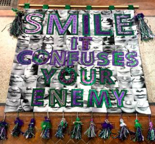 """Smile it confuses your enemy"" banner by Junction Arts in Bolsover, Derbyshire, with textile artist Karina Thompson"