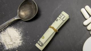 Drugs paraphernalia and US currency