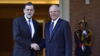 Spanish Prime Minister Mariano Rajoy (L) shakes hands with the Peru's President Pedro Pablo Kuczynski at the Moncloa Palace in Madrid on June 12, 2017.