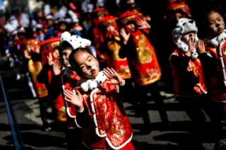 Revellers perform during celebrations for the Chinese New Year parade in Lisbon.