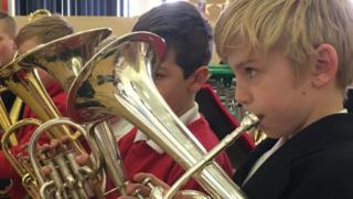 Boys play euphoniums