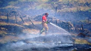 Firefighter tackles the blaze on Winter Hill