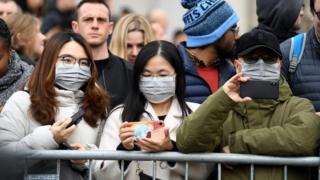 People wearing masks at London celebrations